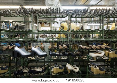 MOSCOW - FEB 21, 2017: Conveyor with modern female shoes in workshop in Ralf Ringer factory. Company production is 1,5 million pairs per year