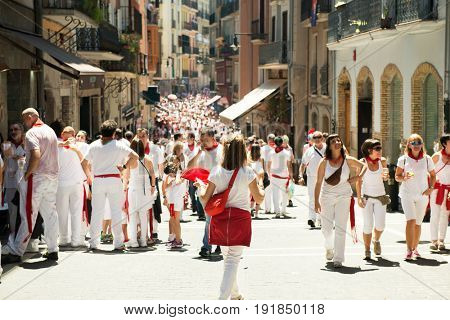 People celebrate San Fermin festival in traditional white abd red clothing with red necktie, 06 July 2016, Pamplona, Navarra, Spain. Crowd