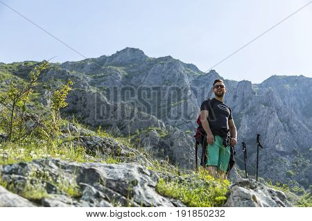 A young man taking a break during his hiking in the Apuseni Mountains in Transylvania Romania.