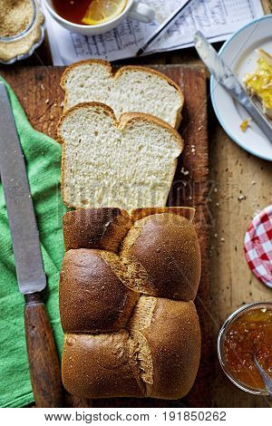 Sweet bread Brioche with butter and orange marmalade