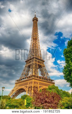 Eiffel Tower at sunset in Paris France. HDR. Romantic travel background. Eiffel tower is traditional symbol of paris and love.