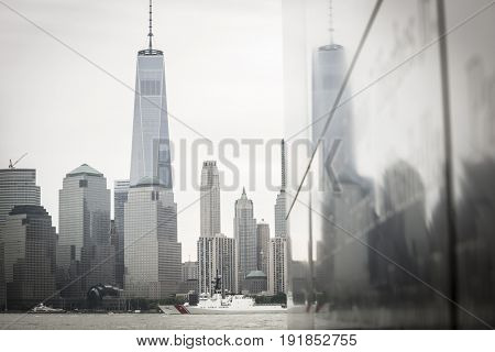 USCGC Hamilton (WMSL 753) passes the Freedom Tower and WTC in Manhattan with reflections on the NJ 9/11 Empty Sky Memorial during the Parade of Ships, Fleet Week New York, JERSEY CITY NJ MAY 24 2017.
