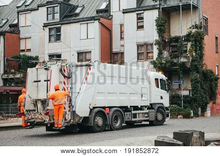 Daily collection of waste in Germany the city of Furth in Europe. Transportation of waste for subsequent disposal. Workers.