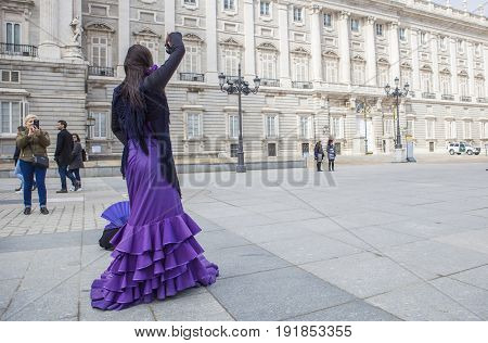 Madrid Spain - february 26 2017: Flamenco dancer performing in front of Royal Palace Madrid Spain