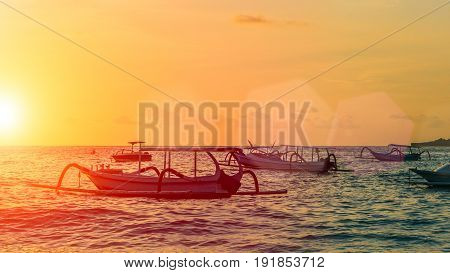 Sunset with boats in the foreground, Sunflares, Nusa Penida, Indonesia
