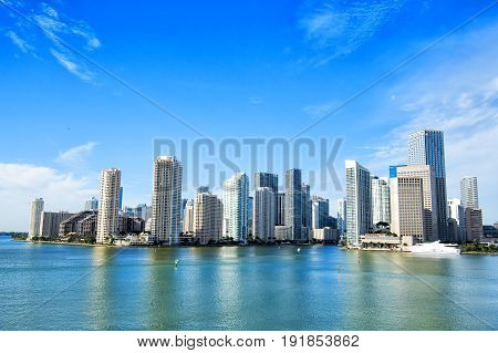 Miami skyscrapers with blue cloudy skyyacht or boat next to Miami downtown Aerial view south beach