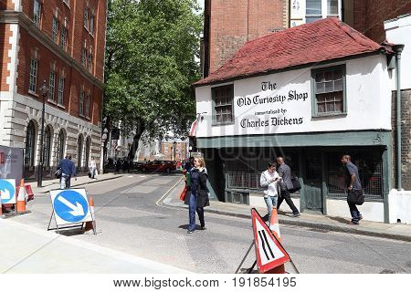 LONDON, GREAT BRITAIN - MAY 23, 2014: This is an ancient wooden building which was built in 16th century and has gained worldwide fame thanks to the novel by Charles Dickens.