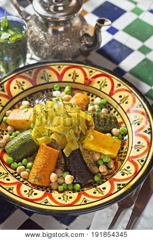 Moroccan couscous with vegetables carrots, aubergine and courgette