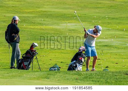 VIERUMYAKI FINLAND August 22: Golf Players batting the ball in the sports centre for a game of Golf Vierumaki Finland August 22 2016.