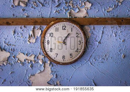 Clock in abandoned school in Pripyat city in Chernobyl Exclusion Zone Ukraine