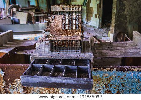 Retro cashbox in abandoned Pripyat city in Chernobyl Exclusion Zone Ukraine