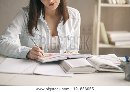 Young woman study at home alone taking notes