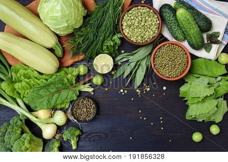 Composition On A Dark Background Of Green Organic Vegetarian Products: Green Leafy Vegetables, Mung