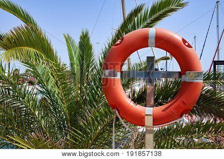 Lifebuoy in the marina for yachts. Red circle in the seaport of Marina de las Dunas, Guardamar del Segura, Alicante, Spain
