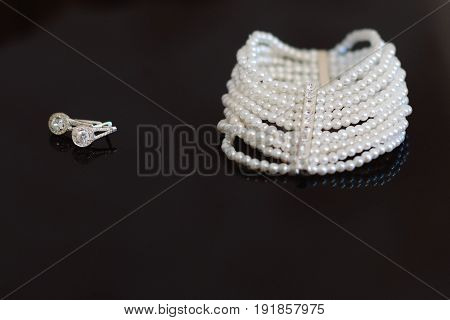 Decoration on the bride's hand, white pearls on a black background