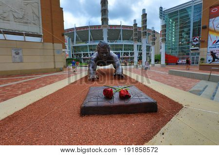 CINCINNATI, OHIO - JUNE 18, 2017: A bronze Statue of Pete Rose doing his head first dive was unveiled at Great American Ballpark in Cincinnati, OH.