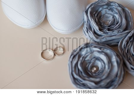 Beautiful silver background with wedding rings and stars.
