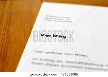 A letter on a wooden table - contract