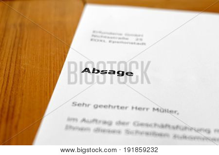 A letter on a wooden table - application rejection