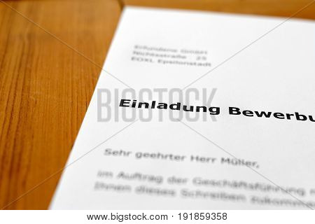 A letter on a wooden table - job interview invitation