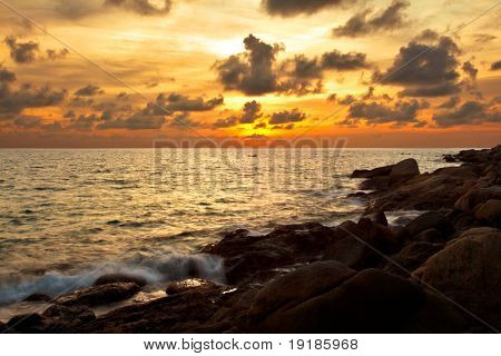 Tropical sunset in the sea. Phuket island. Thailand poster