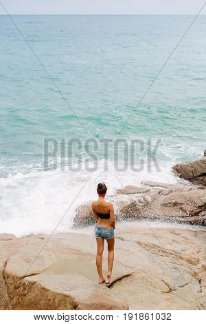 Beautiful Girl In Short Shorts Walk On Big Stones.