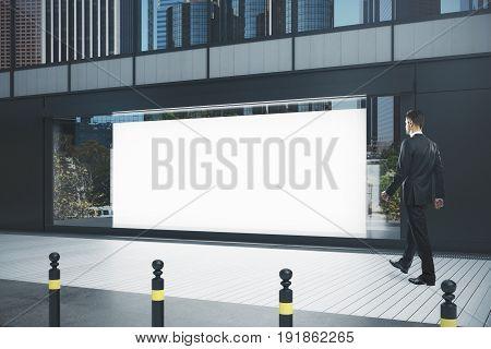 Man Walking Past Showcase