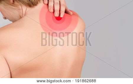 Young Woman With Neck Pain, Massaging Her Shoulder