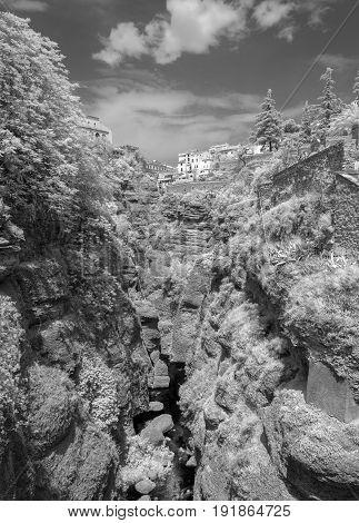 Infrared image of the El Tajo ravine on the south side of the New Bridge in Ronda Spain.