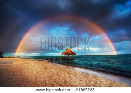 Rainbow over Wooden Water Villa in Punta Cana Dominican Republic