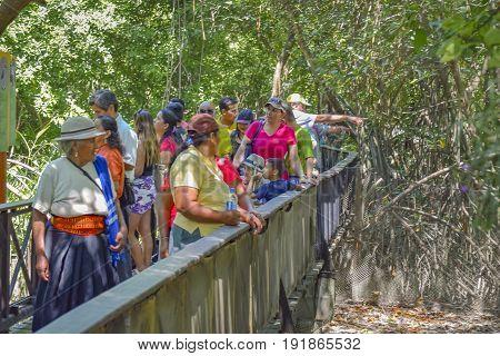 GUAYAQUIL, ECUADOR, MAY - 2016 -People at historic park zoo located at samborondon neighborhood Guayaquil Ecuador
