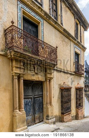 Old Spanish building with ironwork railings and balcony