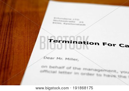 A letter on a wooden table - notice of termination