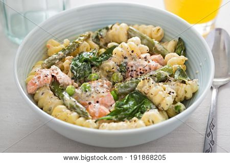 Salmon asparagus primavera with spinach and green asparagus
