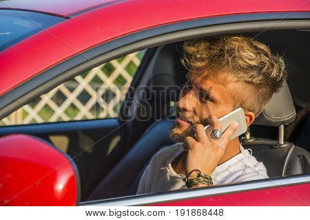 Inattentive Handsome Young Man Calling on Phone While Driving a Car.