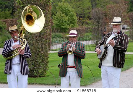 Wisley, Surrey, Uk - April 30 2017: Trad Jazz Trio In Striped Boating Blazers, Playing Sousaphone, C
