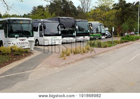 Wisley, Surrey, Uk - April 30 2017: Coaches Parked In A Parking Lot Waiting For Passengers To Return