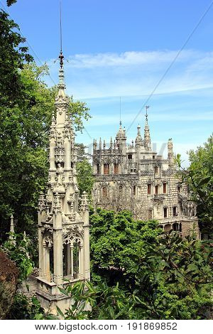 Sintra, Portugal. View on Quinta da Regaleira estate and palace, hidden in the trees at the spring.