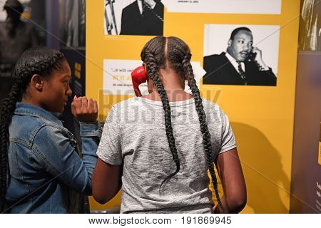 Memphis, TN, USA - June 9, 2017: Young girls inside the National Civil Rights Museum and the site of the Assassination of Dr. Martin Luther King Jr.