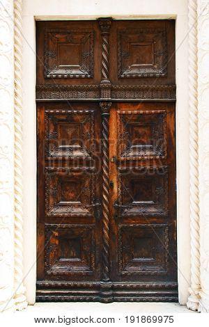 Old wooden medieval doors in the old town of Kotor Montenegro