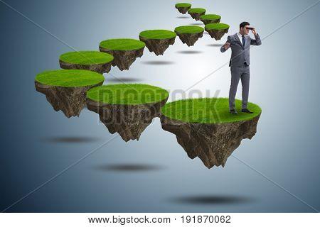 Businessman on flying island with binoculars
