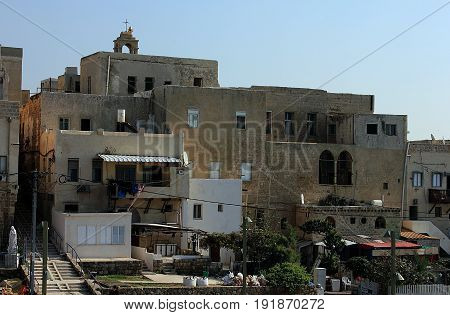 House, windows and balconies in the old city of Akko (Acre), Israel.