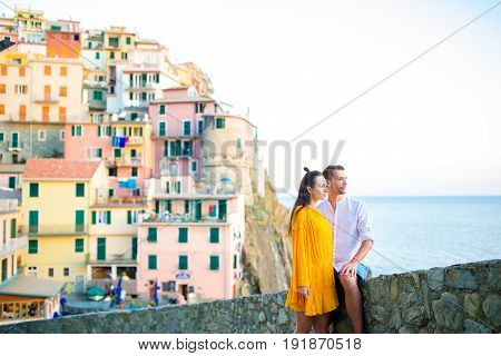 Tourists looking at scenic view of Manarola, Cinque Terre, Liguria, Italy