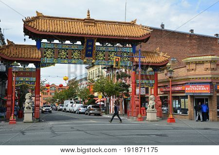 Victoria BC,Canada,April 21st 2015.Victoria's Chinatown with the Gate Of Harmonius Interest guarding the entrance to Canada's  oldest Chinatown.