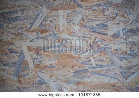 Brown wooden wallpaper residues of wood pressed wood residues texture