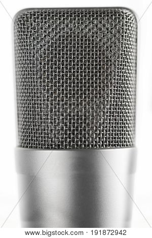 Professional large diaphragm microphone. Front view. White background