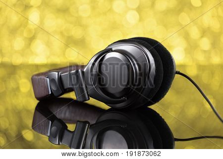 Dj Headphones On Yellow Background Out Of Focus
