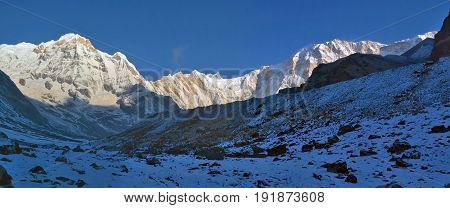 Snowy Mountain Landscape Panorama in Himalaya. Sunrise Annapurna South peak, Nepal, Annapurna Base Camp Track.