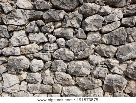rocky stone wall background texture - large natural rocks