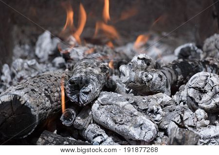 Burning of firewood in the grill with high temperature